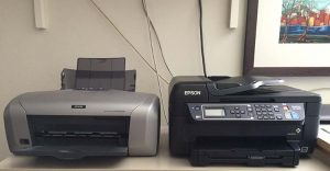 Picture of my old Epson R220 and my new Epson WF-2650 printer