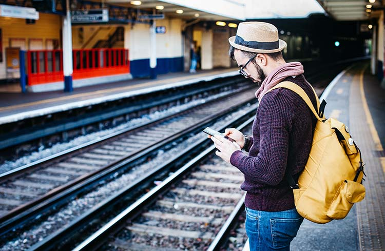 Stay connected while traveling - getting work done while waiting for a train.