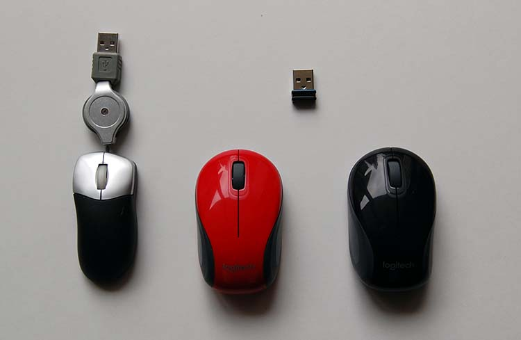Comparing my old USB laptop mouse to the Logitech M187 wireless computer mouse - red and black versions