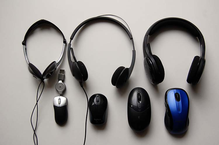 Selection of my wireless headsets and wireless computer mouse over the years